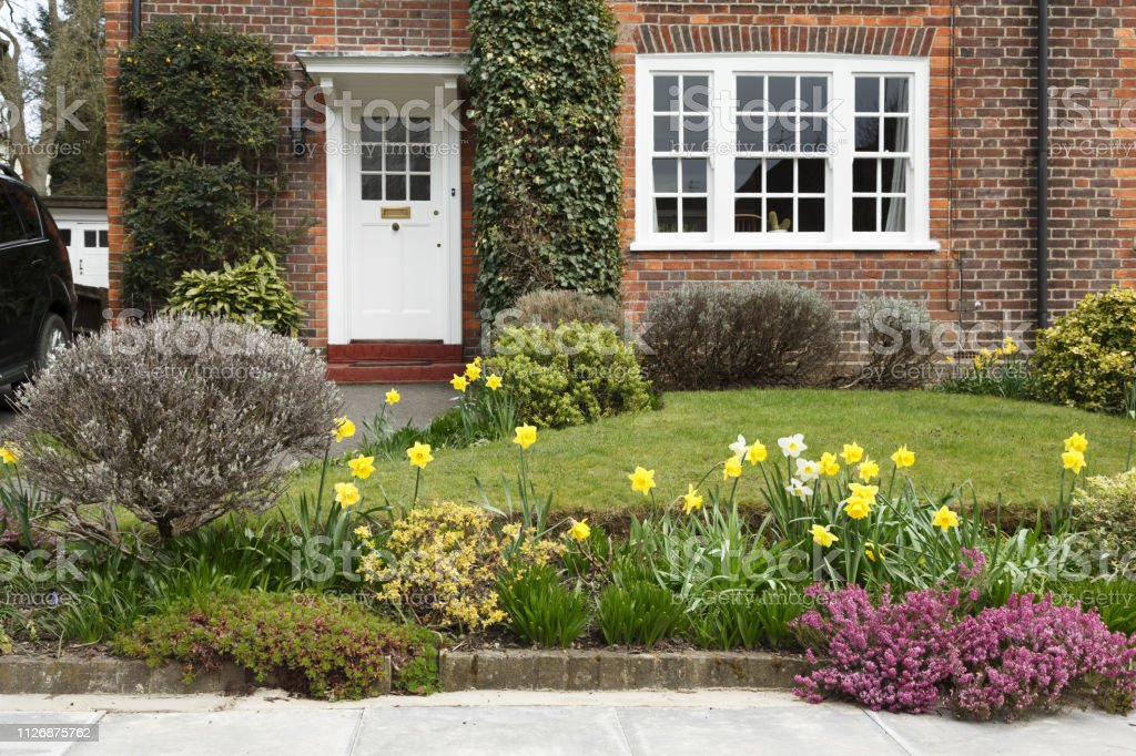 A period house in Pinner, London, with a front garden planted with...