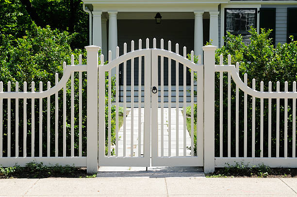 front gate and fence - fence stock photos and pictures
