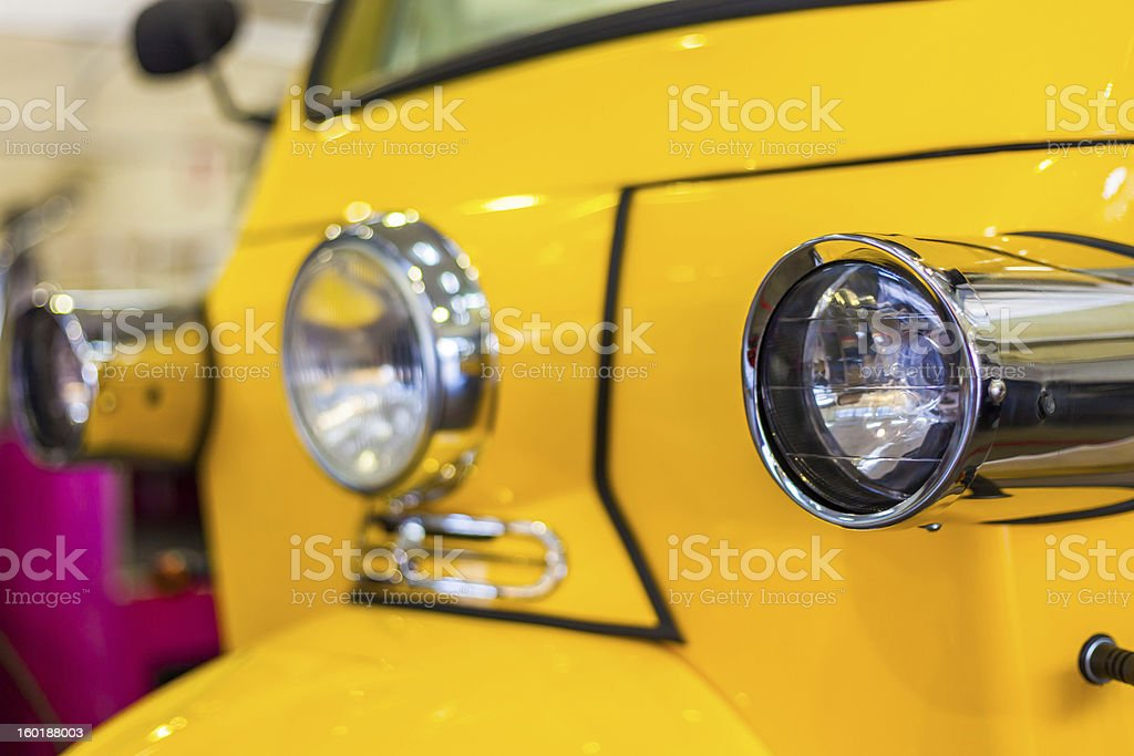 Front lights of a yellow Tuktuk royalty-free stock photo