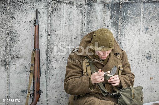 Stock photo of a soldier eatting a canned ration.