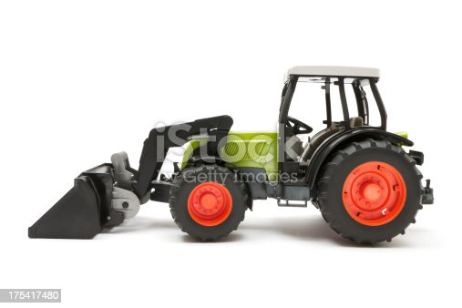 Plastic toy bulldozer isolated on a white background.