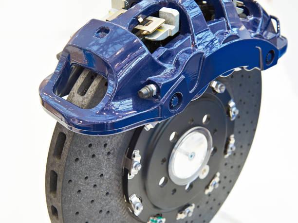 Front monoblock six piston caliper and carbon ceramic brake disc stock photo