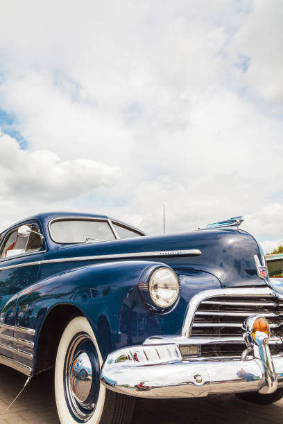 front of a blue fifties chevrolet fleetline car - classic cars stock photos and pictures