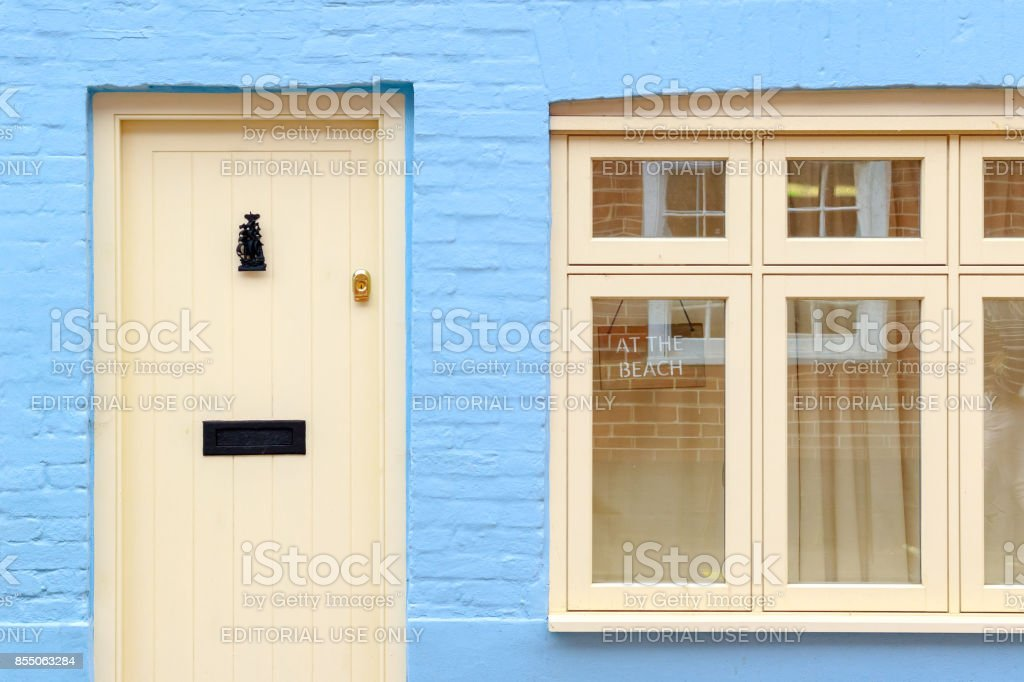 Front of an English cottage with a AT THE BEACH sign in the seaside town Southwold of the UK stock photo