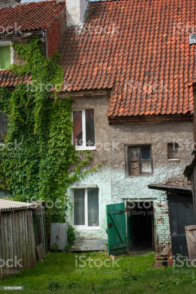 Front of an old house with tiled roof stock photo