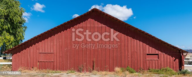 Rustic red wood barn in the countryside of the Santa Ynez Valley near Buellton, California