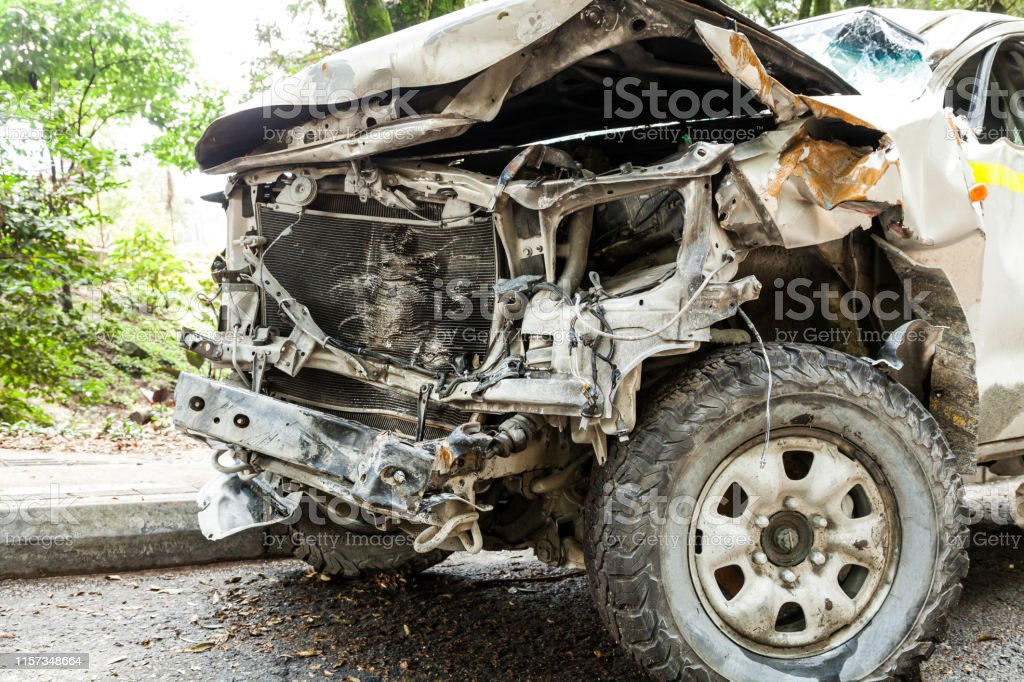 Front of automobile damaged by traffic accident.