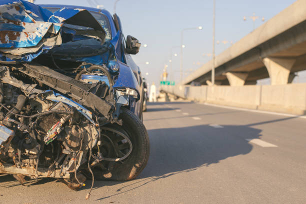 Front of blue car get damaged by accident on the road,copy space. Front of blue car get damaged by accident on the road,copy space. traffic accident stock pictures, royalty-free photos & images