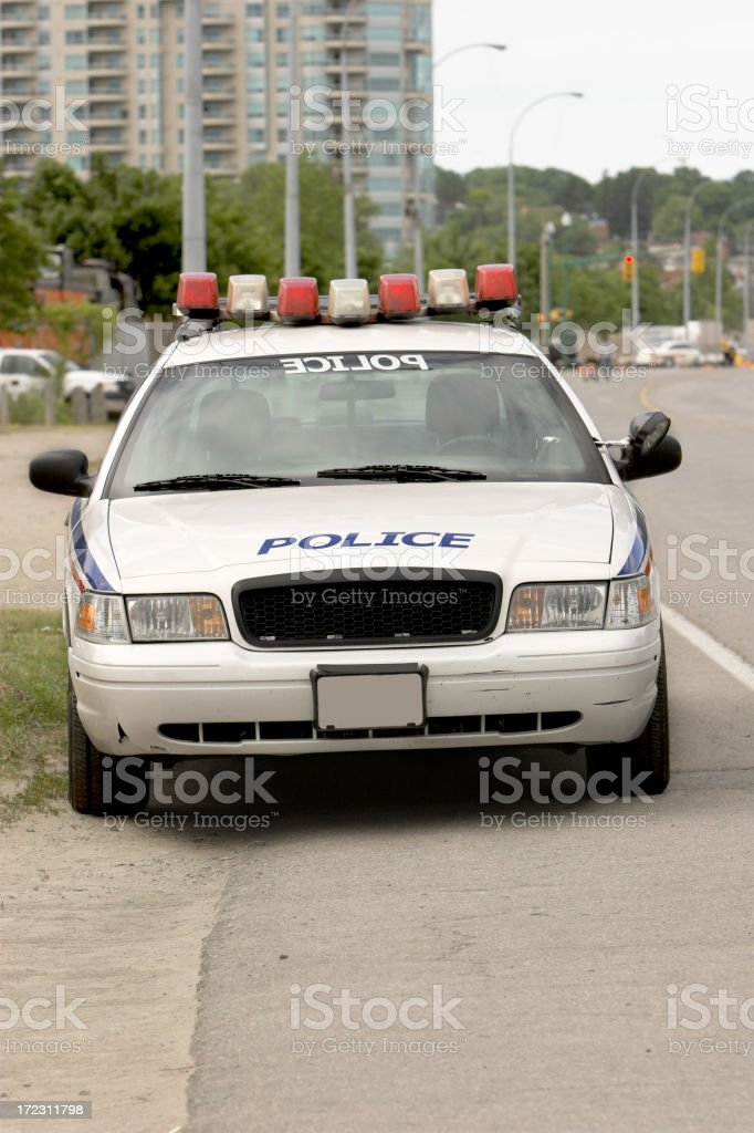 Front of police car parked on a city street stock photo