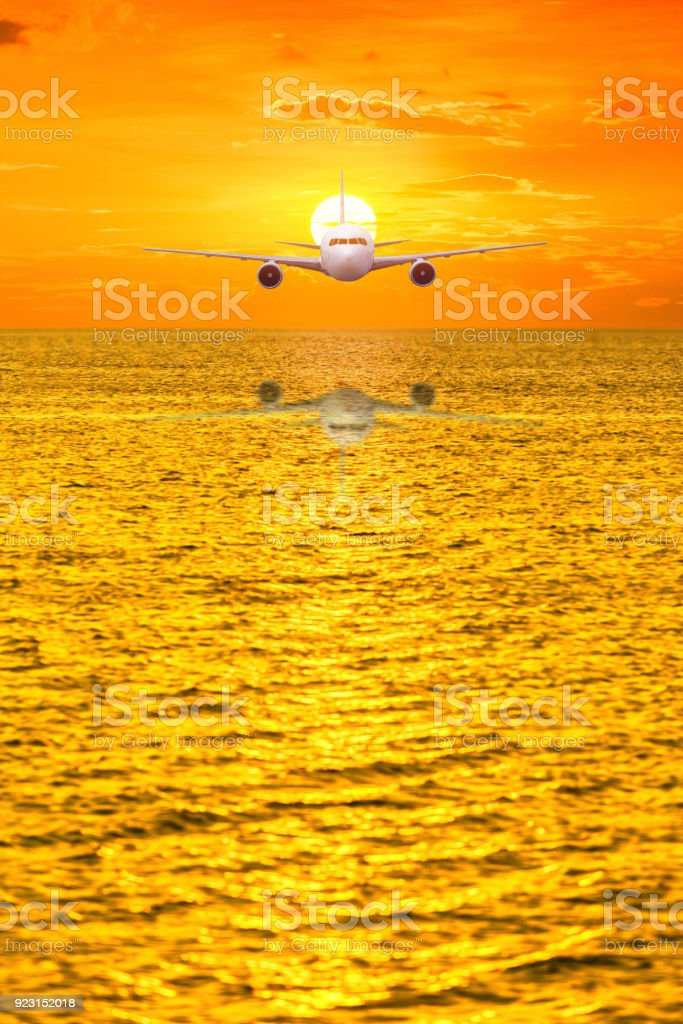 Front of real plane aircraft, on seascape and sunset background stock photo