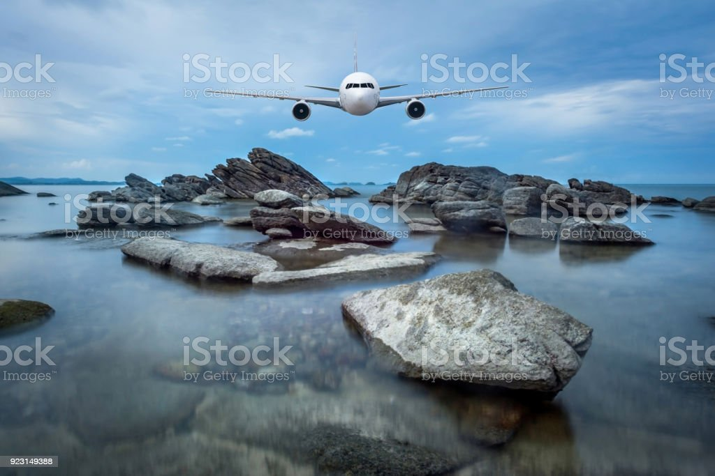 Front of real plane aircraft, on seascape background stock photo