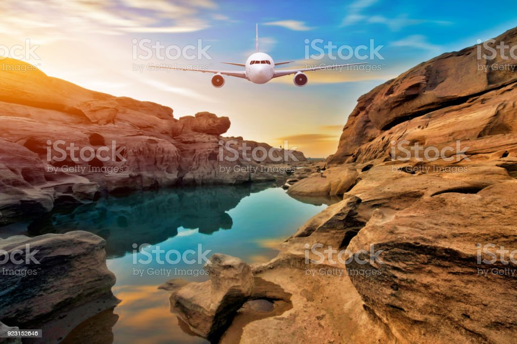 Front of real plane aircraft, on sunset mountain rock background stock photo
