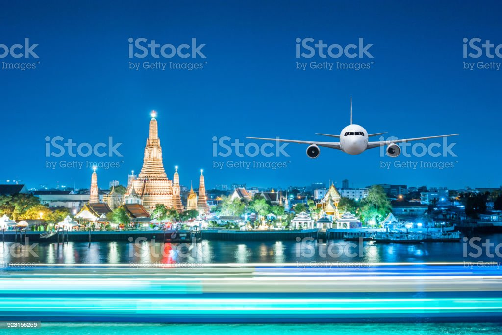 Front of real plane aircraft, on Wat Arun at Twilight time background stock photo