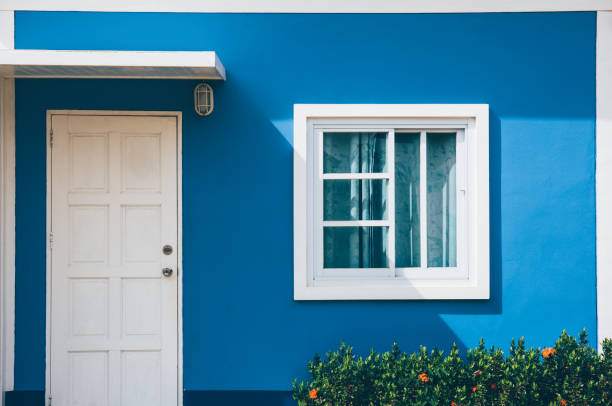 Front of resort with door and window on green background Front of resort with door and window on blue backgroundFront of resort with door and window on green background front door stock pictures, royalty-free photos & images