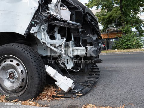 Car crash detail with damaged automobile  in Berlin, Germany.