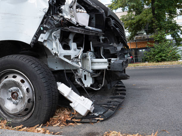 Front of white van  damaged by accident stock photo