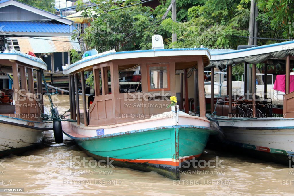 Front of wooden Passenger boat in Chao Phraya river. stock photo