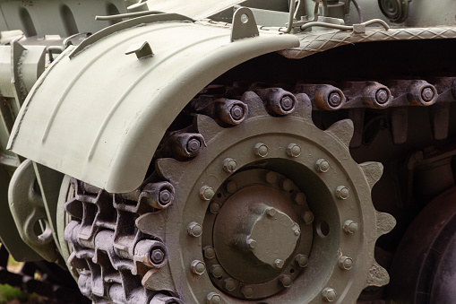 front part of a heavy tracked tank with a wing and a caterpillar