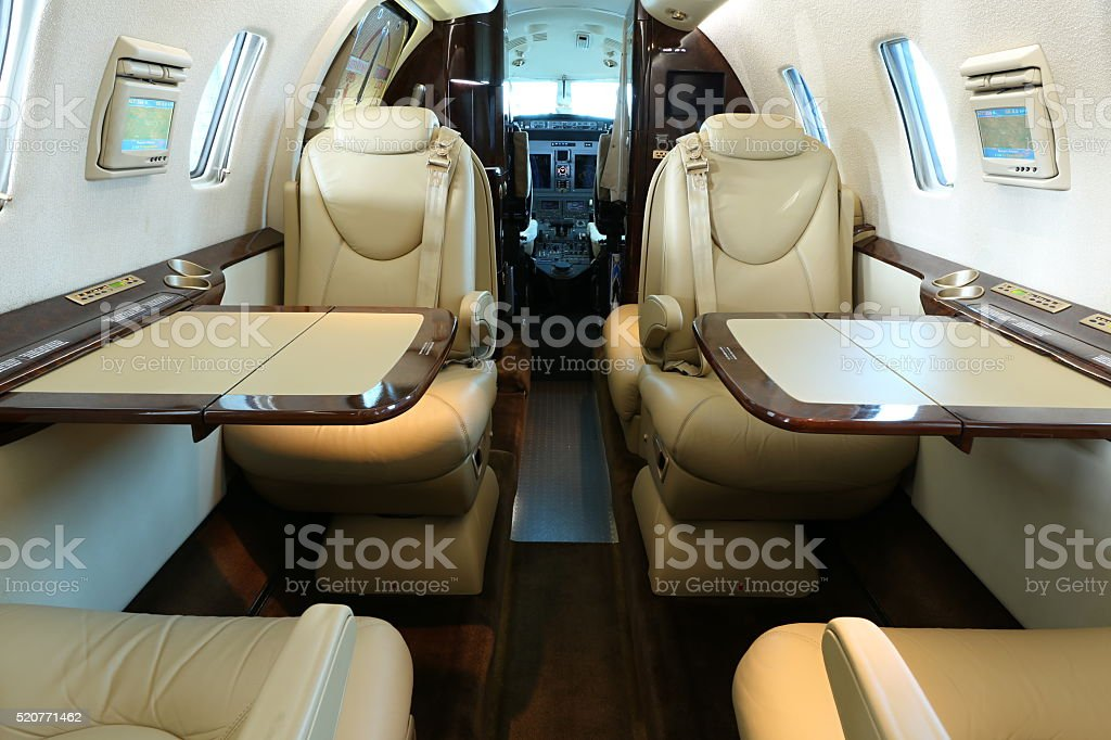 Front part of business jet cabin stock photo