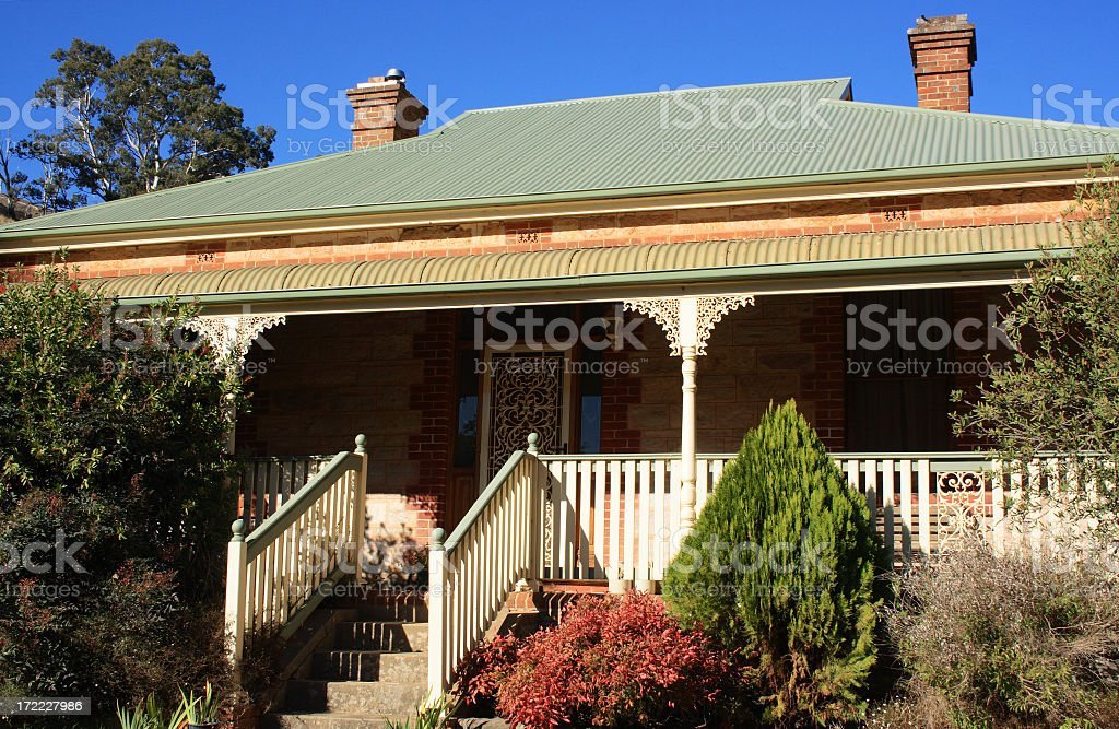 Front porch and steps of 1900s Victorian Farmhouse stock photo