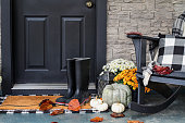 istock Front Porch Decorated for Autumn with Buffalo Plaid 1249579569