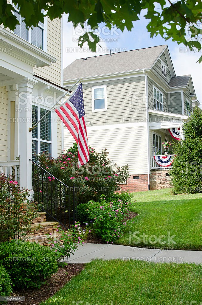 Front Porch Of A House With An American Flag Stock Photo More