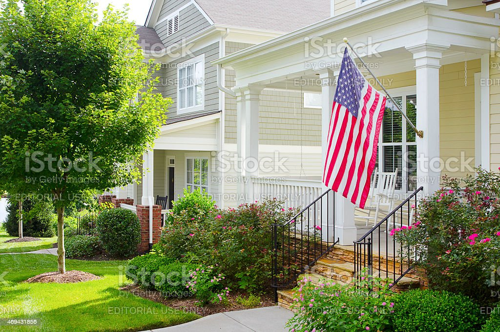 Front Porch of a House with an American Flag stock photo
