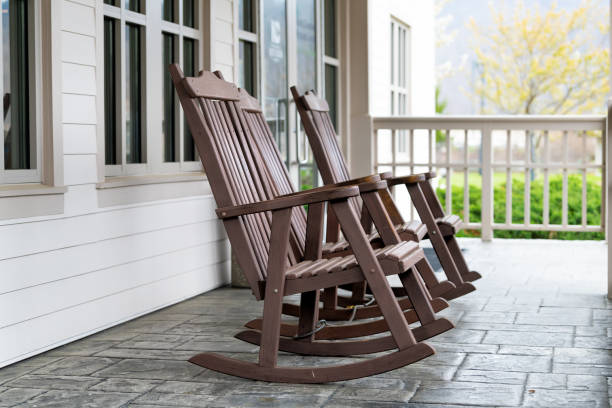 Front porch of house with brown rocking chairs and nobody in traditional american house Front porch of house with brown rocking chairs and nobody in traditional american house southern usa stock pictures, royalty-free photos & images