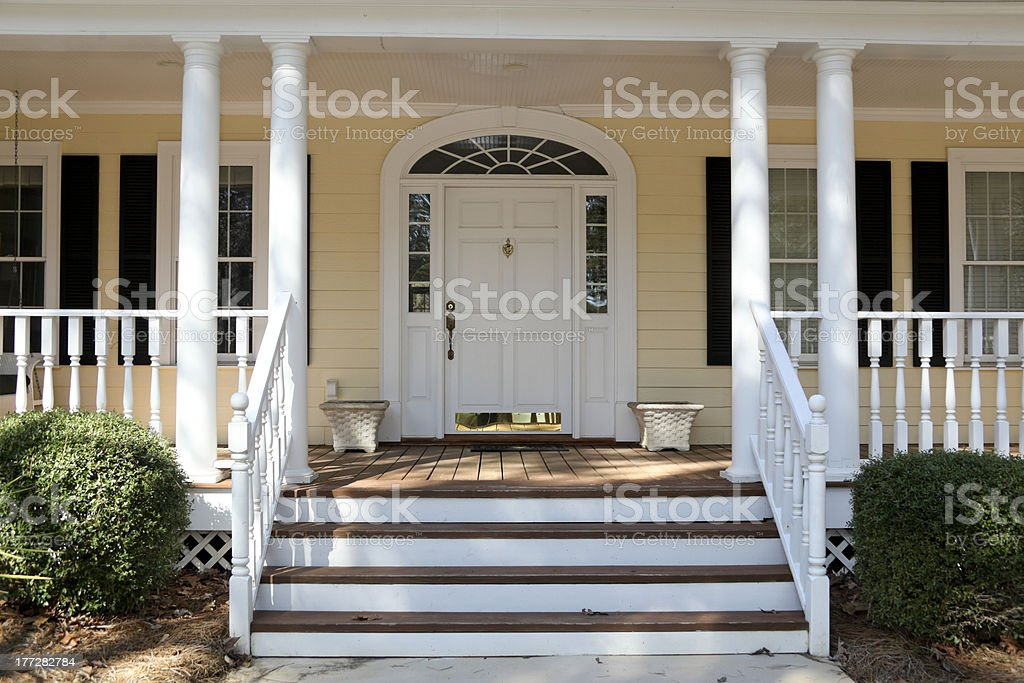 Front porch steps of house with columns, veranda stock photo