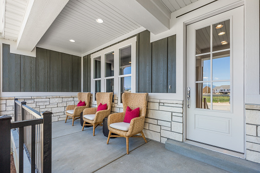 Front glass door with concrete porch