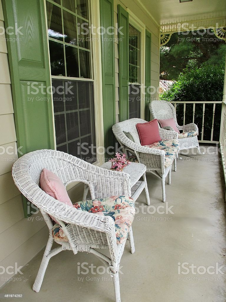 Front Porch with White Wicker Furniture stock photo