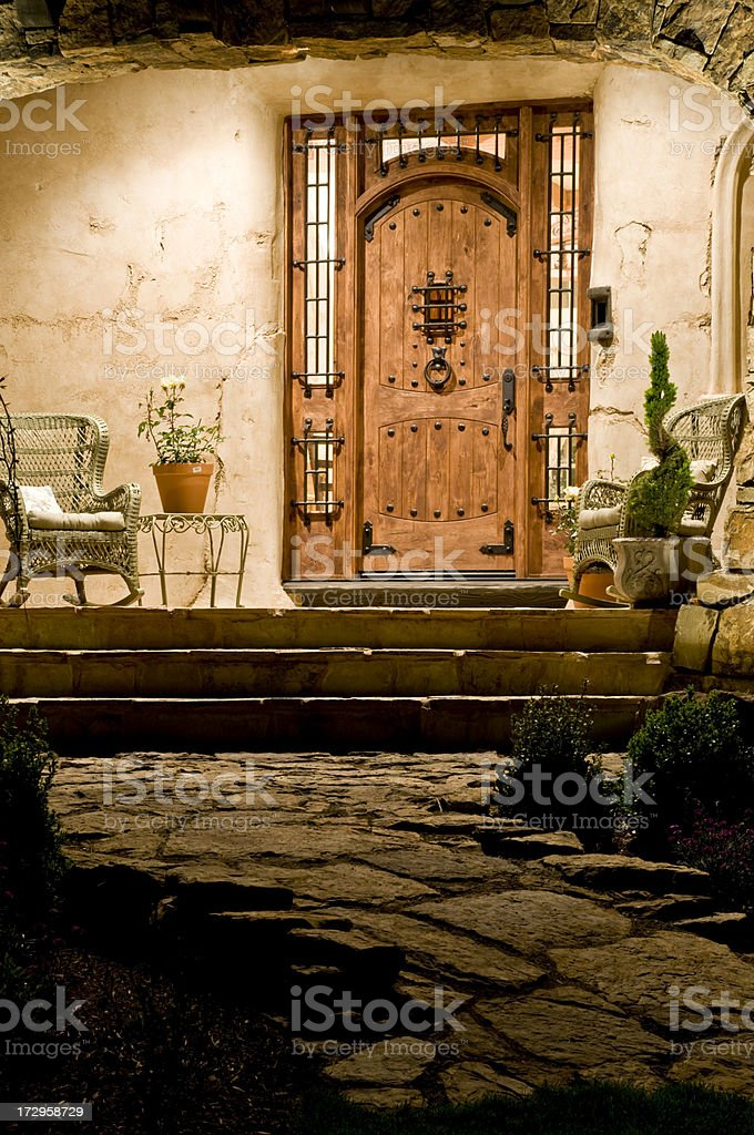 Front porch,beautiful door with stone royalty-free stock photo