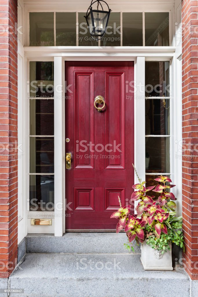 Front reddish-brownish door with an inviting exterior stock photo