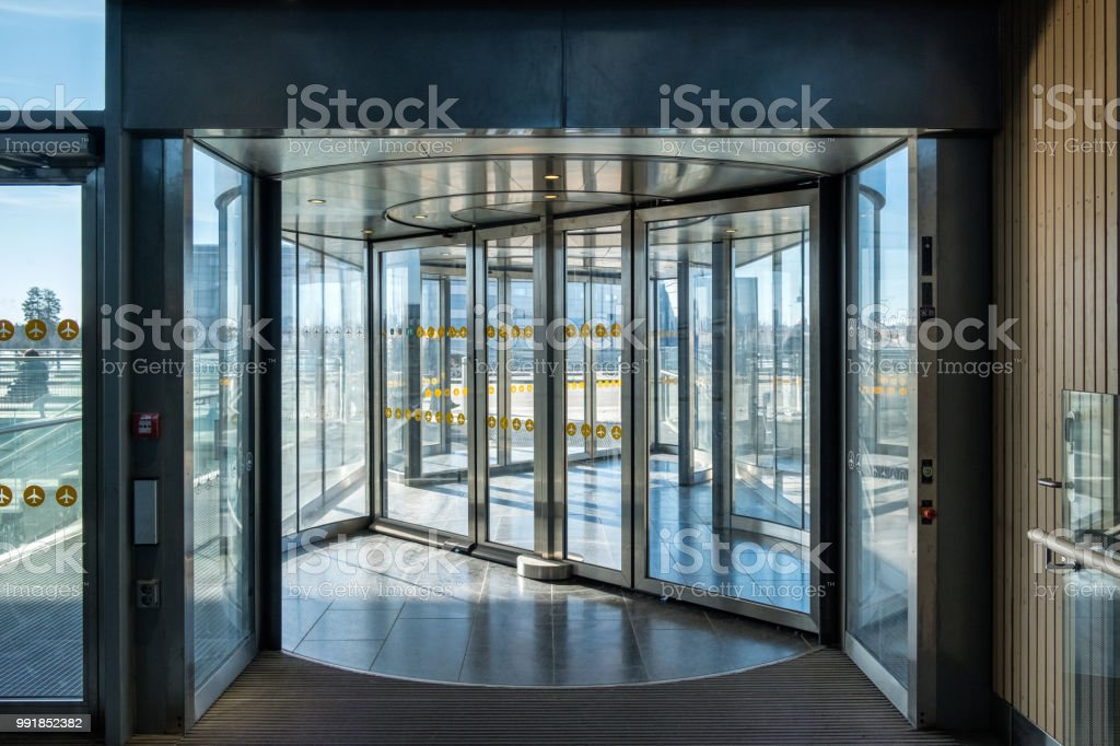 Front revolving transparent automatic rotate door stock photo