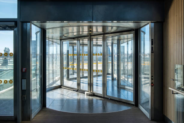 Front revolving transparent automatic rotate door Front revolving transparent automatic rotate door in the airport automatic stock pictures, royalty-free photos & images