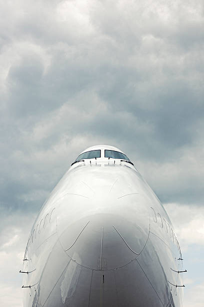 Front Section of Cargo Aircraft Against Moody Sky stock photo