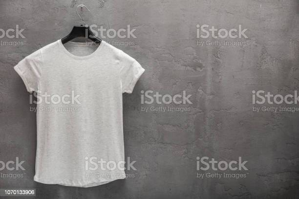 Front side of female grey melange cotton tshirt on a hanger and a picture id1070133906?b=1&k=6&m=1070133906&s=612x612&h=2doxym7 zlti69x6ohe9p0zou9py6cb8dgahngwtsmg=