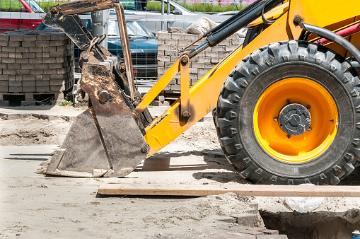 Front side shovel and tire of earth mover and loader bulldozer excavator construction machinery on the street