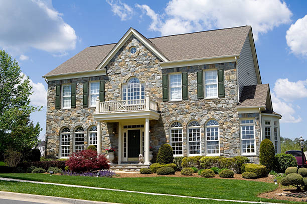 Front Stone Faced Single Family House Home Suburban Maryland Well landscaped stone single family house.  Home is a center hall colonial in suburban Maryland, United States.  - see my lightbox for more house images.   colonial style stock pictures, royalty-free photos & images