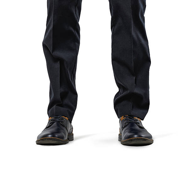 Front view cropped legs of businessman isolated on white background stock photo