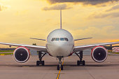 istock Front view exactly of a wide-body aircraft sunset at the airport. 1270650301