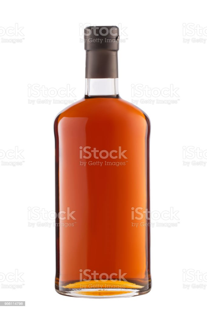 Front view full whiskey, cognac, brandy bottle isolated on white background with clipping path stock photo