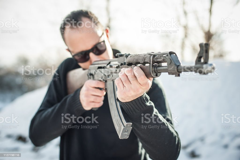 Front view gun point of riffle machine gun. Firearm shooting and...