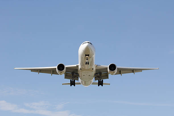 Front view landing airplane stock photo