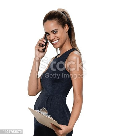 istock Front view / looking at camera / one person / waist up / portrait of 30-39 years old adult beautiful / ponytail african ethnicity / african-american ethnicity female / young women businesswoman / business person / manager standing in the office 1191763675