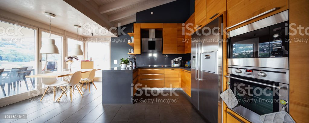 Front view modern wooden kitchen with table and chair stock photo