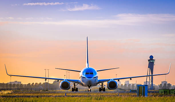 a front view of a airplane about to take off - schiphol stockfoto's en -beelden