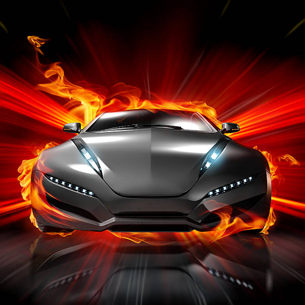 Front view of a futuristic sports car surrounded by flames stock photo