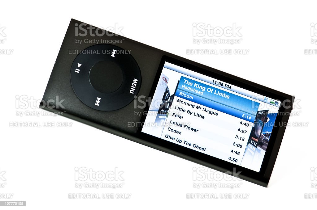 Front view of a grey Apple iPod Nano and headphones stock photo