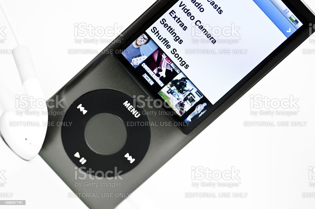 Front view of a grey Apple iPod Nano and headphones royalty-free stock photo